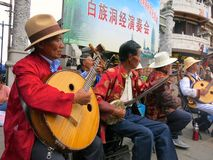 Traditional Chinese Ethnic Music Performance. Chinese traditional Bai ethnic musicians perform an authentic Bai ethnic song at a Bai ethnic festival stock photo