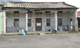 Traditional Chinese Farm House in Taiwan. PINGTUNG, TAIWAN -- FEBRUARY 5, 2016: A traditional Chinese farm house with auspicious saying and quotations around the Stock Photo