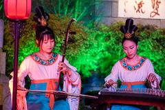 Traditional chinese female musicians and dancers royalty free stock photo
