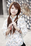 Traditional Chinese girl. Holding the umbrella outdoor Royalty Free Stock Photography