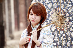 Traditional Chinese girl. Holding the umbrella outdoor Royalty Free Stock Photos