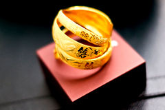 Traditional chinese gold bangles for wedding Stock Photos