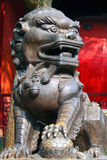 Traditional chinese guardian lion. On red background Stock Photo