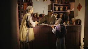 Shanghai - Sep 06: Traditional Chinese herbal medicine shop, wax figure ,china culture art, Sep 06, 2013, Shanghai city stock footage
