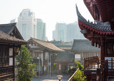 Traditional chinese houses and modern buildings in the backgroun Stock Image