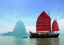 Traditional Chinese June. Traditional June Bahtra red Chinese junk cruise ship in Phang Nga Bay, Phuket, Thailand Royalty Free Stock Image