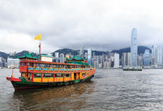 Traditional Chinese Junkboat sailing in Victoria Harbor stock photos