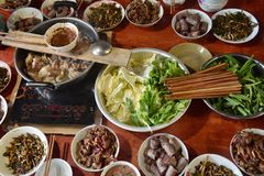 Traditional chinese meal with many plates full of different, delicius and colorful food. Traditional chinese meal includes many plates with different delicius stock image