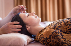 Traditional Chinese medicine. The girl is having a session of acupuncture Royalty Free Stock Photography
