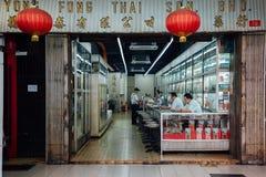 Traditional Chinese medicine store, Kuala Lumpur. Kuala Lumpur, Malaysia - March 17, 2016: Man buys medicine in traditional Chinese medicine store in Chinatown Stock Photo
