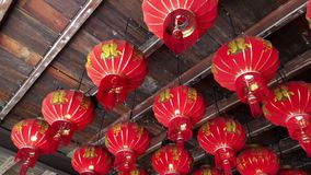 Traditional Chinese New Year Lanterns in small wooden temple. In Phuket Town