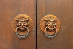 Traditional Chinese old door with lion head knockers Royalty Free Stock Photo