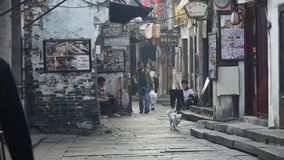 Traditional Chinese old town houses & street,some students drawing.