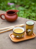 Traditional chinese oolong tea ceremony accessories (tea cups an. D pitcher) on the stone table, selective focus on cup Royalty Free Stock Images
