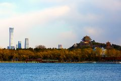 The ancient and modern Beijing city. Traditional Chinese Pavilions on Jingshan hill and the modern central business district buildings, shot from Beihai Park stock photography