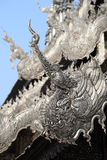 Traditional Chinese Phoenix on Silver roof of Buddhism temple, C Stock Photos
