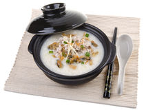 Traditional chinese pork porridge rice gruel served in claypot Royalty Free Stock Image