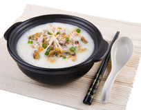 Traditional chinese pork porridge rice gruel served in claypot Stock Photography