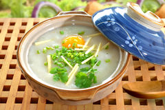 Porridge , congee. Traditional chinese porridge rice gruel in bowl, congee Royalty Free Stock Photography