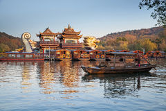 Traditional Chinese recreation boat with tourists and boatman Stock Photography