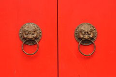 Traditional Chinese red door with knob in an old temple Stock Photography