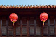 Traditional chinese red lanterns on dark wood windows background Stock Images
