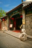 The entrance to a traditional Chinese restaurant in Beijing, richly decorated with a pair of stone lion sculptures and red lantern royalty free stock images