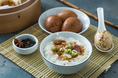 Traditional chinese rice porridge on dinner table royalty free stock images
