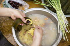 Traditional Chinese rice-pudding. Manufacturing process of one of traditional Chinese food, rice-pudding Stock Photo