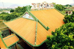 Chinese house roof China. East Asian Chinese traditional house roof of classical building with yellow glazed tiles and green edge. Chinese glazed tile roof in stock images