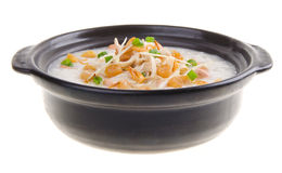 Traditional chinese scallop porridge rice gruel served in claypo Royalty Free Stock Image