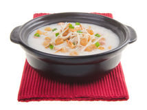 Traditional chinese scallop porridge rice gruel served in claypo Stock Image