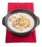 Traditional chinese scallop porridge rice gruel served in claypo Stock Photo