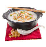 Traditional chinese scallop porridge rice gruel served in claypo Stock Photos
