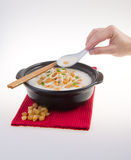 Traditional chinese scallop porridge rice gruel served in claypo Royalty Free Stock Photos