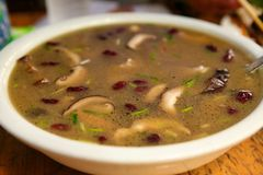 Traditional Chinese soup with beans and mushrooms, cooked in the village of Dazhay. royalty free stock photo