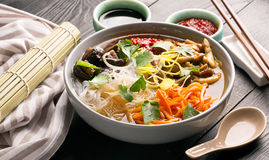 Traditional chinese soup. With noodles, mushrooms and vegetables Stock Photos