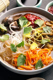 Traditional chinese soup. With noodles, mushrooms and vegetables Royalty Free Stock Photography
