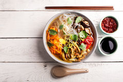 Traditional chinese soup. With noodles, mushrooms and vegetables Stock Photography