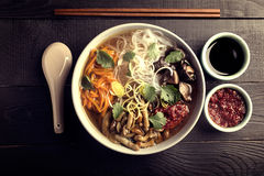 Traditional chinese soup. With noodles, mushrooms and vegetables Royalty Free Stock Images