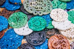 Traditional Chinese stone amulets made of jade at Upper Lascar R. Ow historical market, Hong Kong stock photography
