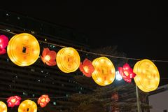 Traditional chinese street lanterns in a shape of a coins and flowers stock photos
