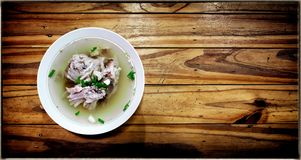 Traditional Chinese style chicken bone soup on a wooden backgrou. Nd royalty free stock image