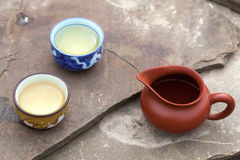 Traditional chinese tea ceremony accessories (cups and pitcher). On the stone table, selective focus Stock Photography