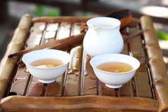 Traditional chinese tea ceremony accessories. (tea cups and pitcher) on the tea table, selective focus Royalty Free Stock Images
