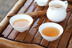 Traditional chinese tea ceremony accessories (cups and pitcher). On the tea table, selective focus Royalty Free Stock Image