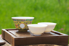 Traditional chinese tea ceremony accessories ( gaiwan and cups). On the tea table Stock Images