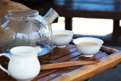 Traditional Chinese tea ceremony accessories, glass pot and cups Stock Photos