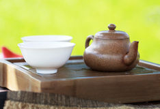 Traditional chinese tea ceremony accessories. (tea pot and tea pair) on the tea table, selective focus Royalty Free Stock Images