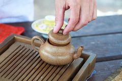 Traditional chinese tea ceremony accessories. (tea pot and tea table Royalty Free Stock Image